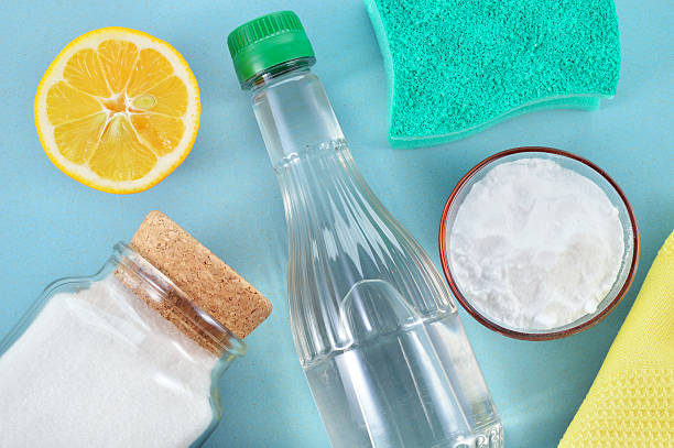 Natural cleaners. Vinegar, baking soda, salt and lemon. Eco-friendly natural cleaners. Vinegar, baking soda, salt, lemon and cloth. Homemade green cleaning. cleaning equipment stock pictures, royalty-free photos & images