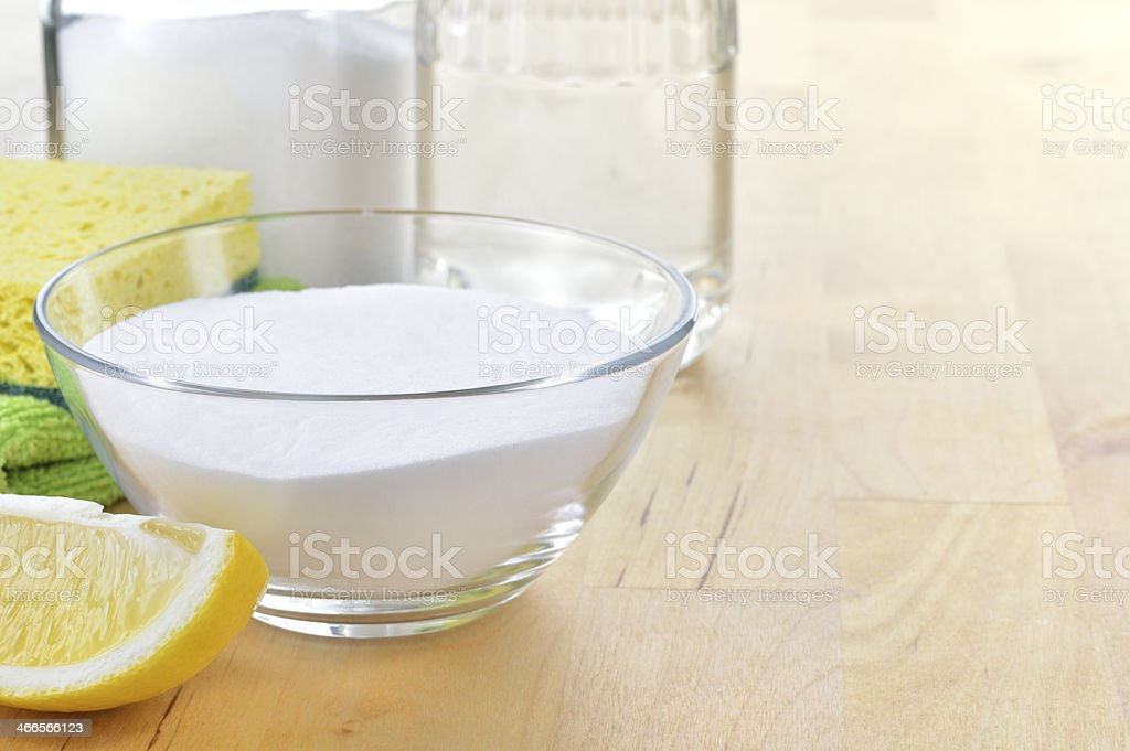 Natural cleaners. Vinegar, baking soda, salt and lemon. stock photo