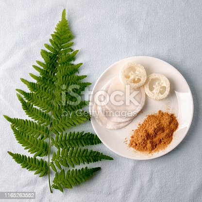 istock Natural cleaning products mustard powder with natural luffa and cotton sponge. Eco friendly. Zero waste concept. Plastic free. 1165263552