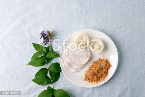 istock Natural cleaning products mustard powder with natural luffa and cotton sponge. Eco friendly. Zero waste concept. Plastic free. 1165263557