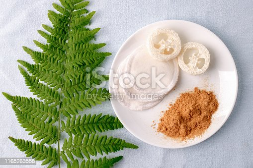istock Natural cleaning products mustard powder with natural luffa and cotton sponge. Eco friendly. Zero waste concept. Plastic free. 1165263558