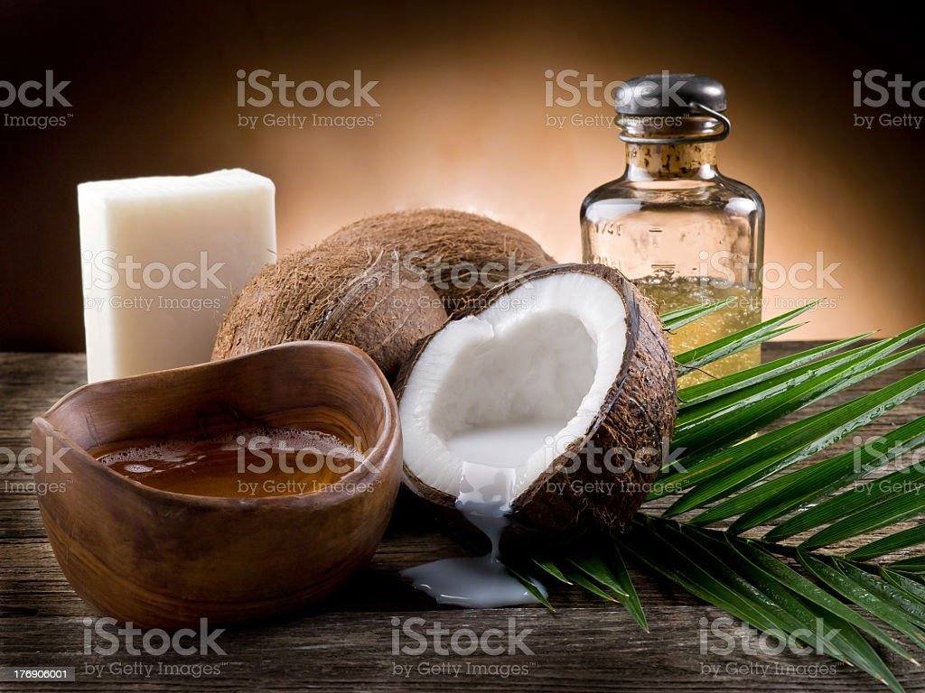 Natural coconut milk and walnut oil with soap stock photo