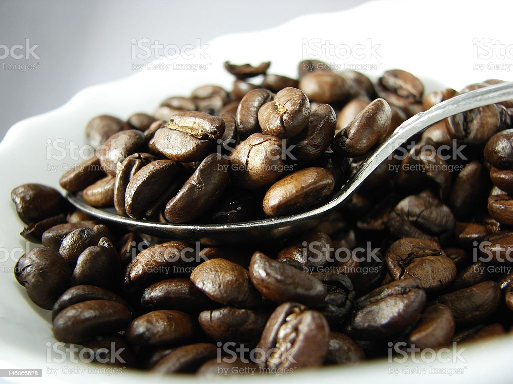 Natural coffee beans and spoon stock photo