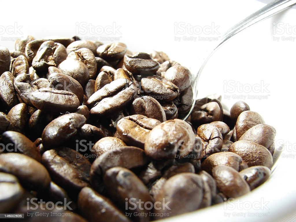 Natural coffee beans with spoon stock photo