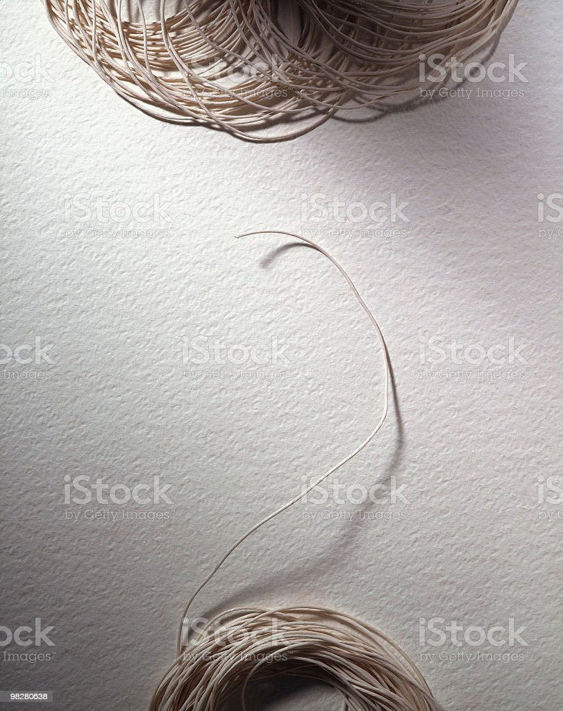 Natural colour strings on a sheet of white paper royalty-free stock photo