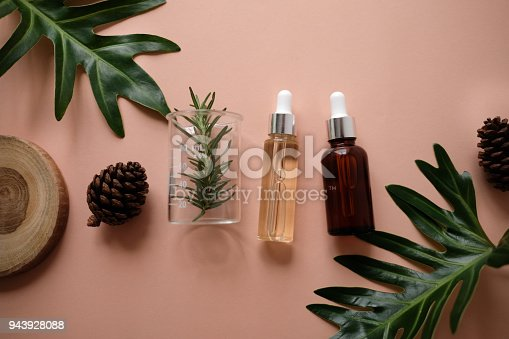 istock natural cosmetic cream , serum, skincare blank bottle packaging with leaves herb, wood . bio organic product.beauty and spa concept. 943928088