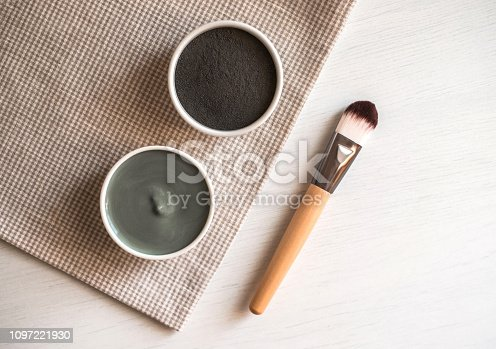 istock Natural cosmetic facial masks in ceramic bowls on textile background. 1097221930