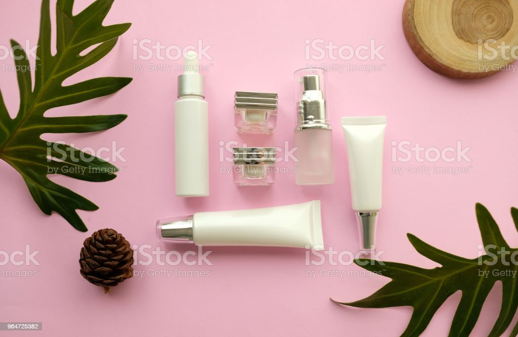 natural cosmetic makeup , organic skincare serum product packaging with leaves herb on nature beauty concept, herb bio and spa concept.pink background. royalty-free stock photo