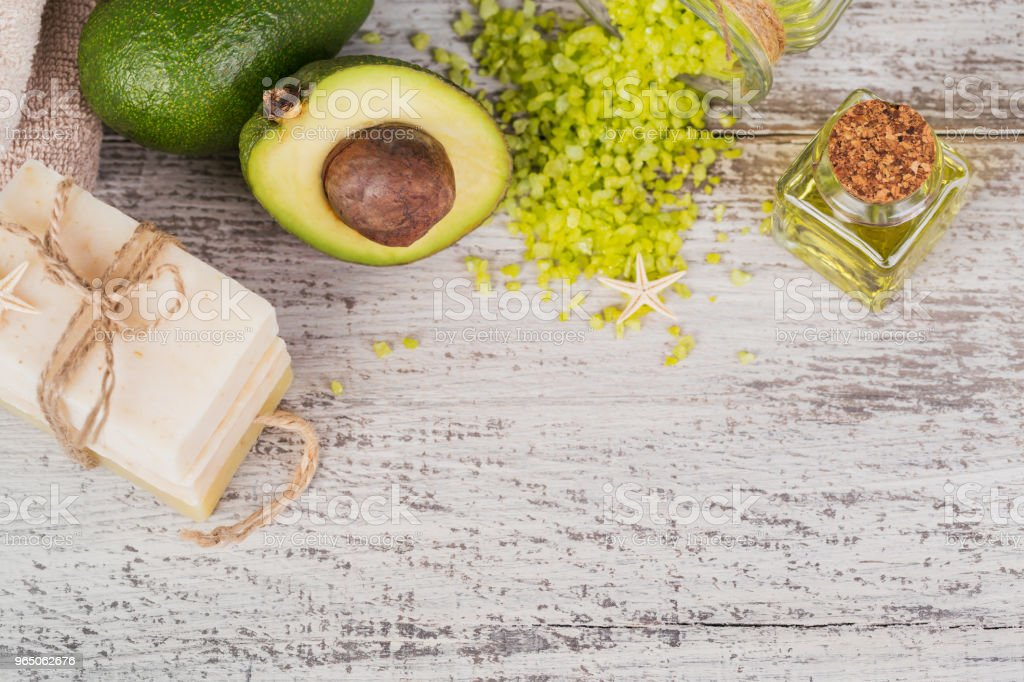 Natural cosmetic oil and natural handmade soap with avocado royalty-free stock photo