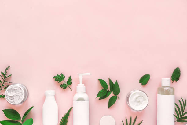 Natural cosmetics and green leaves stock photo