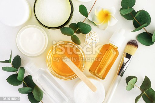 Top view bottles with facial treatment product white background.