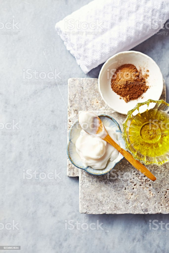 Natural cosmetics on gray stone background( face balm, argan oil and red clay) stock photo