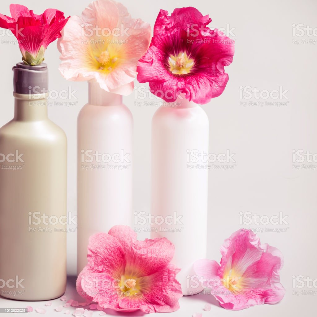 Natural Cosmetics set and flowers on gray background. Natural Ecology...
