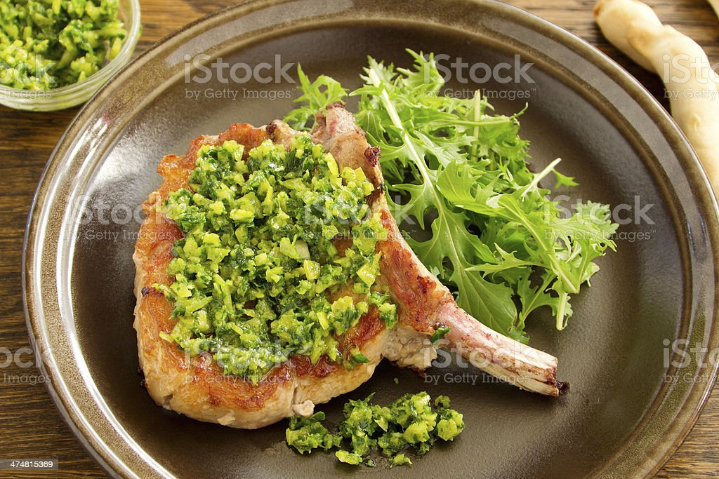 natural cutlet on the bone with gremolatoy. royalty-free stock photo