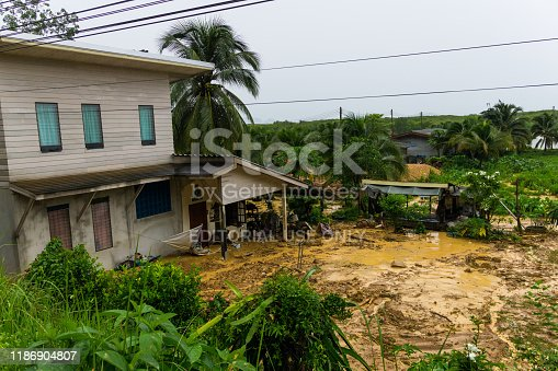 Ko Lanta, Thailand - July 19 2019: A natural disaster has occurred in the form of a landslide. Torrential rain has fallen during Monsoon season causing tonnes of mud to slide and flood several houses.