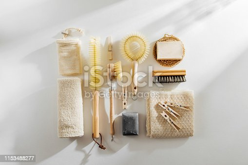 1168256931 istock photo Natural dish brush and cleaning tools with Soap. Zero waste concept. Plastic free. Flat lay, top view 1153488277