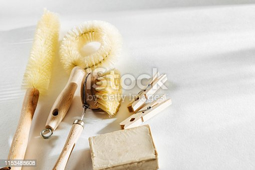 1169442284 istock photo Natural dish brush and cleaning tools with Soap. Zero waste concept. Plastic free. Flat lay, top view 1153488608