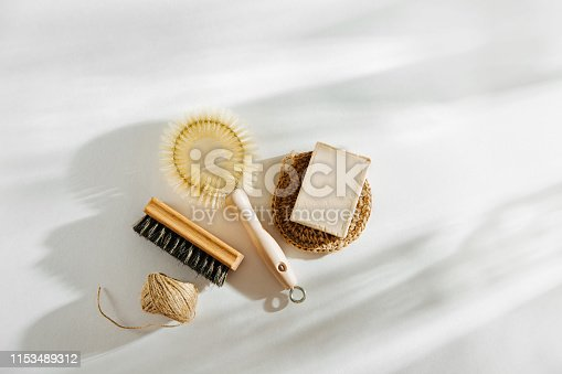 1168256931 istock photo Natural dish brush and cleaning tools with Soap. Zero waste concept. Plastic free. Flat lay, top view 1153489312