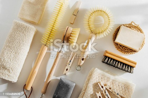 1168256931 istock photo Natural dish brush and cleaning tools with Soap. Zero waste concept. Plastic free. Flat lay, top view 1153489509