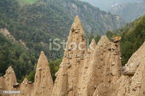 istock Natural earth pyramids near Ritten-Lengmoos, South Tyrol, Italy 1300635409