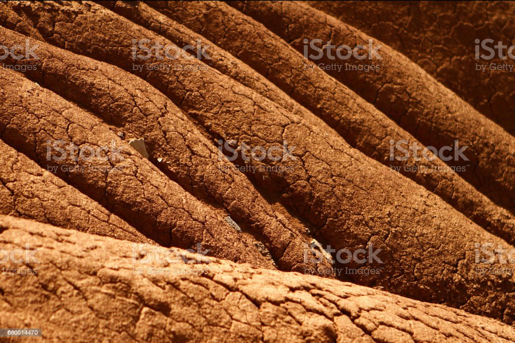 Natural erosion on the cracked clay slope stock photo
