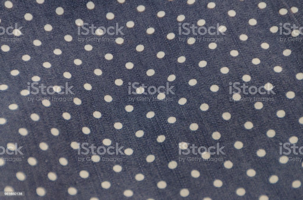 natural fabric texture with pattern, white circles on dark blue stock photo