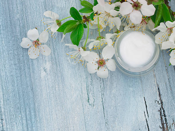 natural facial cream with spring flowers stock photo