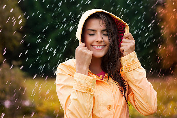 Natural female beauty in autumn rain Natural female beauty in autumn rain waterproof clothing stock pictures, royalty-free photos & images