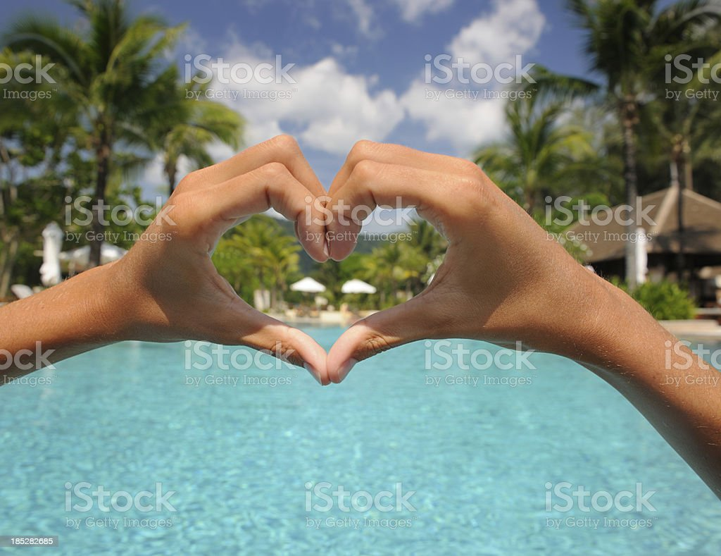 Natural Female Hands Heart with Pool Background (XXXL) royalty-free stock photo