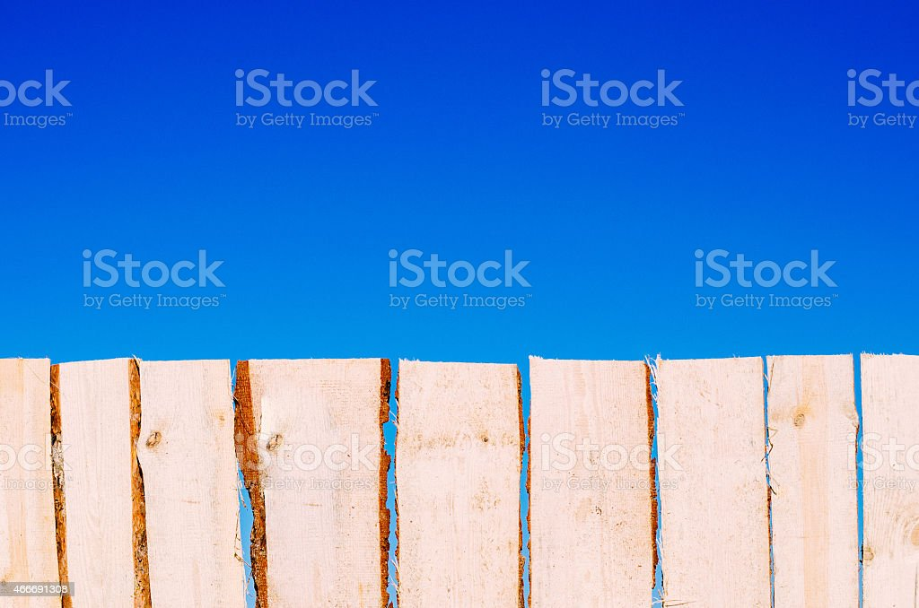 Natural fence wooden fence against blue sky stock photo
