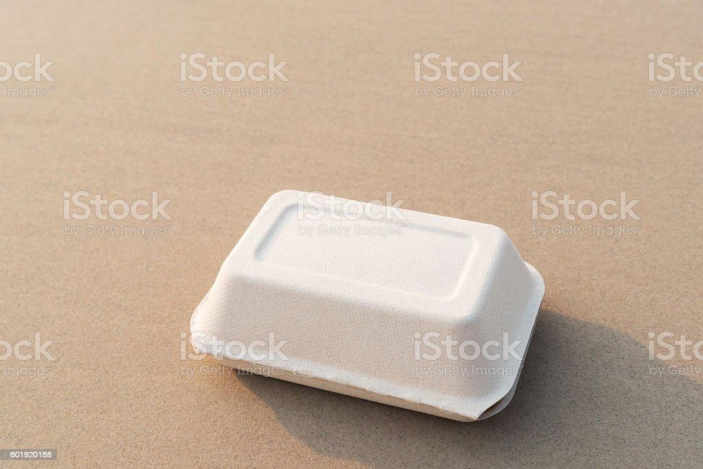 Natural food box on sand beach stock photo