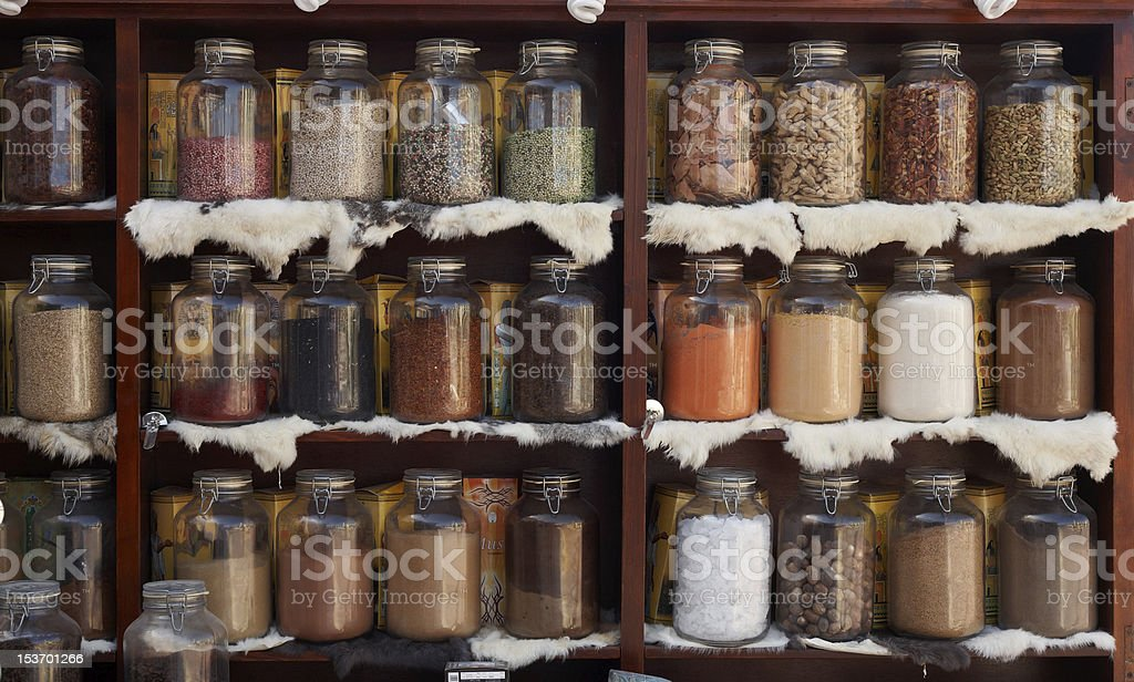 Natural food items and medical herbs in glass jars stock photo