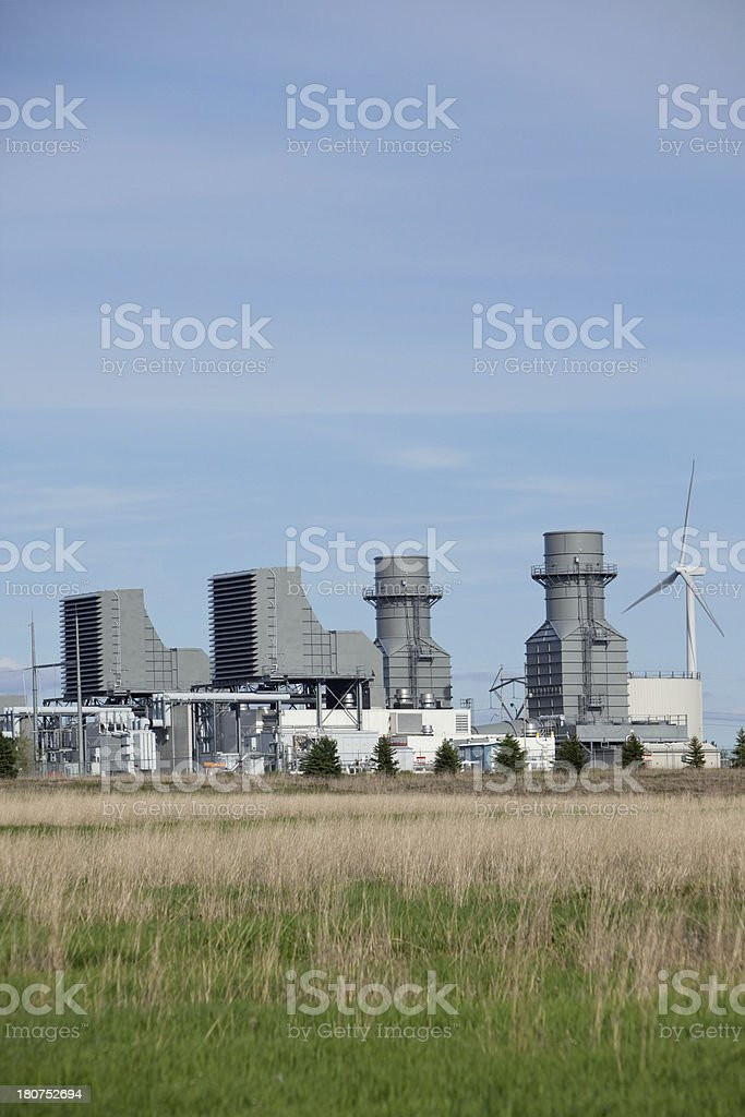 Natural Gas 400 Megawatt Electricity Peaking Plant with Wind Turbine stock photo