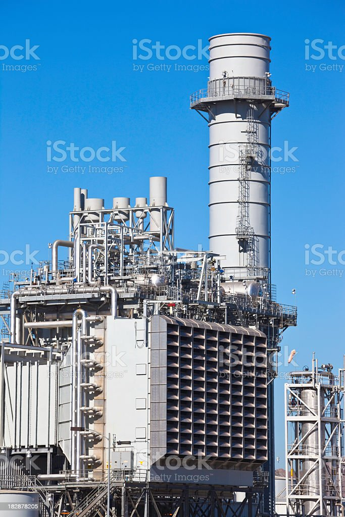 Natural gas and electrical power plant with clear blue skies stock photo