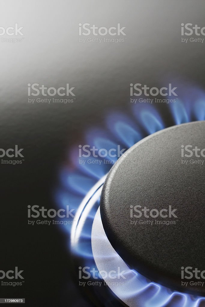 Natural Gas Blue Flame on Kitchen Appliance Stove Burner, Vertical royalty-free stock photo