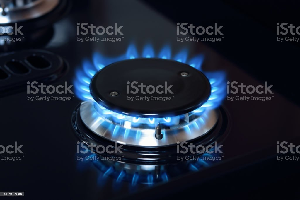 Natural gas burner flame on stove stock photo