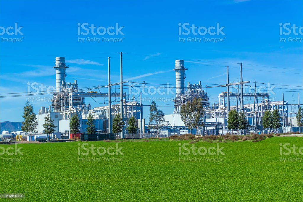 Natural gas fired turbine power plant,spring,field,grass,CA stock photo