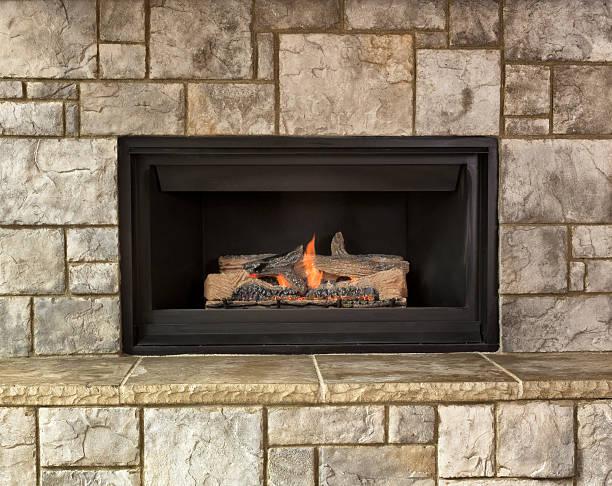 natural gas fireplace for home - gaskamin stock-fotos und bilder