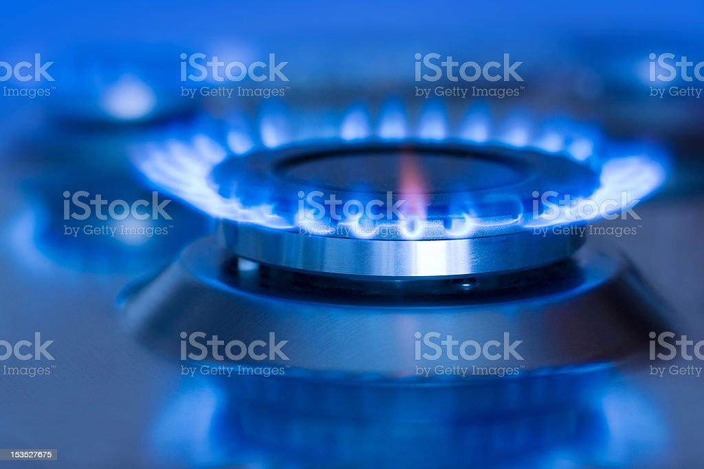 Natural gas is blue and hot when turned on stock photo