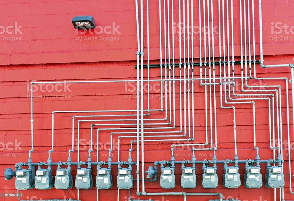Natural gas meters and steel pipes supplying several businesses royalty-free stock photo