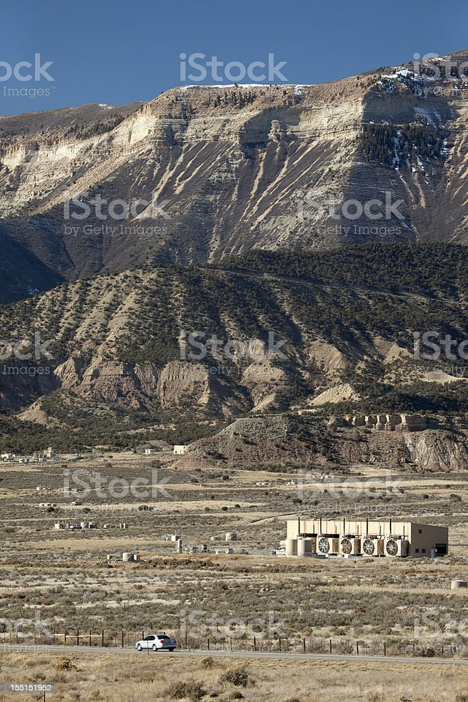 Natural gas oil fields off Interstate 70 Rifle Colorado vertical royalty-free stock photo