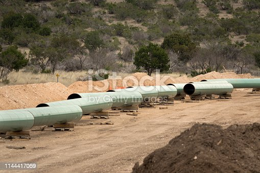 South of Ozona along state highway 163 in the arid Chihuahuan Desert of Crockett County, construction of over 440 miles of 42 inch mainline pipeline will move natural gas from West Texas to the Corpus Christi area through the Gulf Coast Express Pipeline.