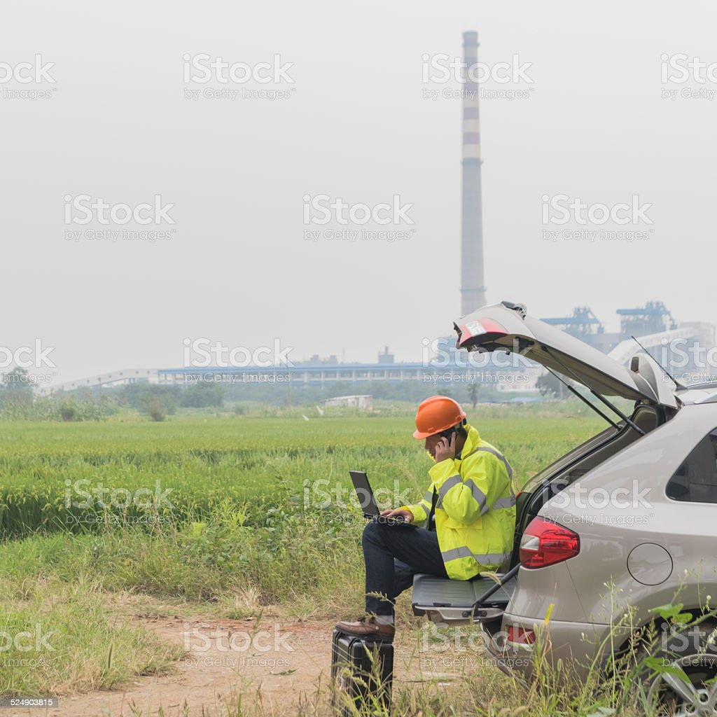 Natural gas plant engineers working on laptop stock photo