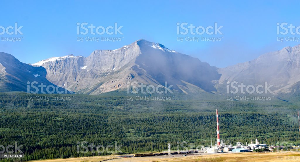 Natural gas processing plant in Crowsnest Valley, Alberta stock photo