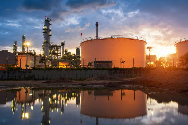 Natural Gas storage tanks and oil tank in industrial plant at twilight stock photo