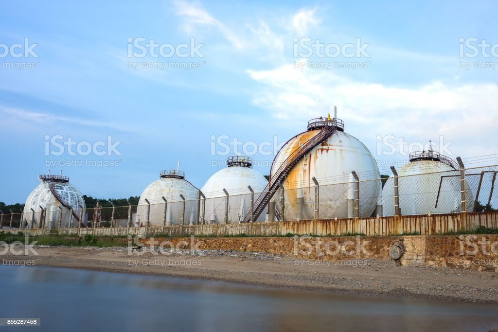 Natural gas tank in the petrochemical industry,Oil and gas industry - Petrochemical factory, Industrial zone and petrochemical plant at sunset'n stock photo