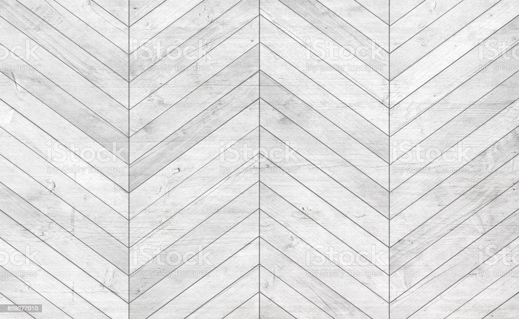 Natural gray wooden parquet herringbone. Wood texture. stock photo