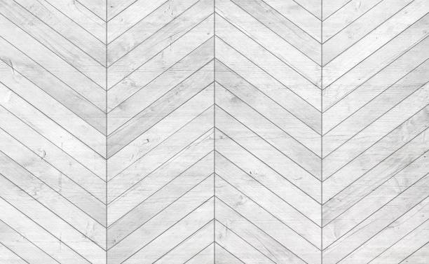 Natural gray wooden parquet herringbone. Wood texture. stock photo