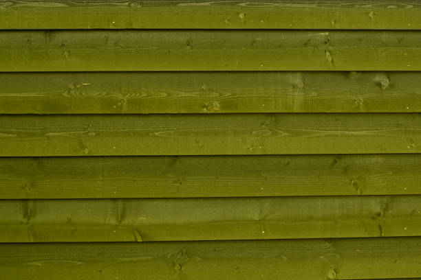 Natural green colour wooden background pattern horizontal planks of a fence stock photo