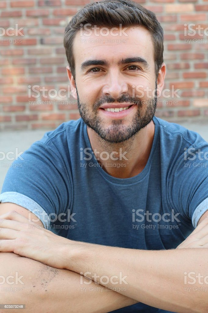 Natural handsome young man smiling stock photo
